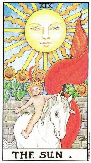 The Sun card from the Rider Waite Tarot Deck.