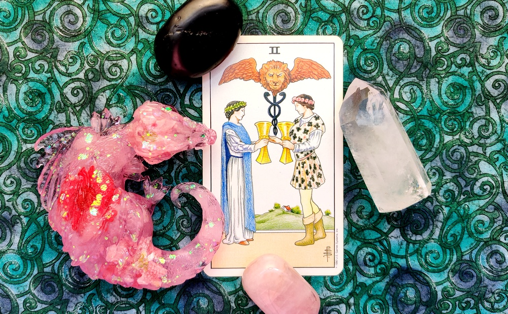 Two of Cups from the Universal Waite Tarot Deck.