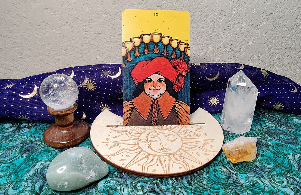 Nine of Cups from the Morgan Greer Tarot.